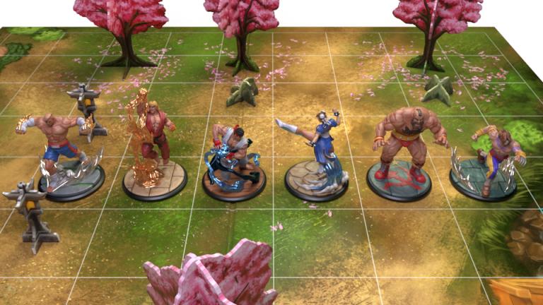 Todas las miniaturas incluidas en la caja básica de Street Fighter Miniatures Game
